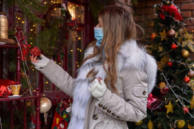 Woman wearing mask Christmas shopping